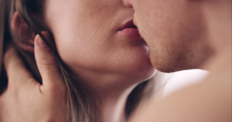 Close up of Attractive young couple kissing engaged in foreplay touching each other | Shutterstock HD Video #10205039