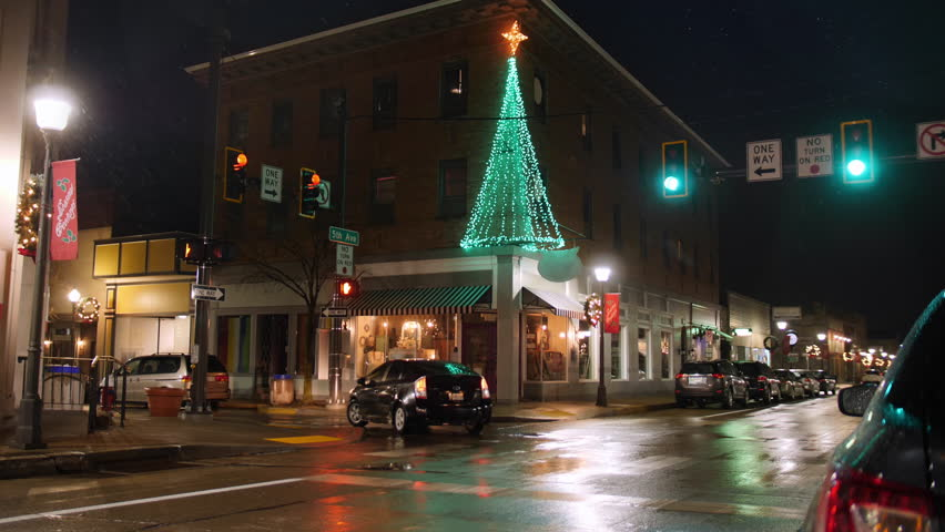 A nighttime establishing shot of a typical street corner in the business district of a small town in America during Christmas season. Pittsburgh suburbs.  	 | Shutterstock HD Video #1020589168