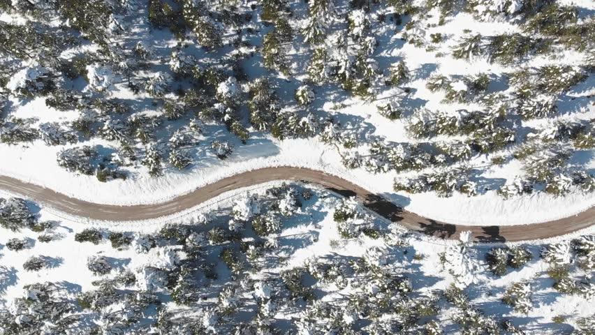Aerial snow road view of the mountain. sakli kent antalya. winter sports  | Shutterstock HD Video #1020653488