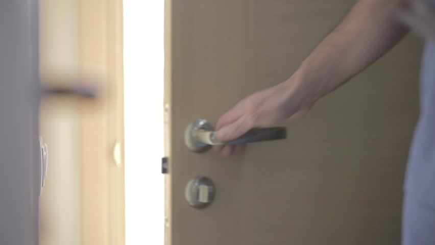 Doctor opening the door  | Shutterstock HD Video #1020761488