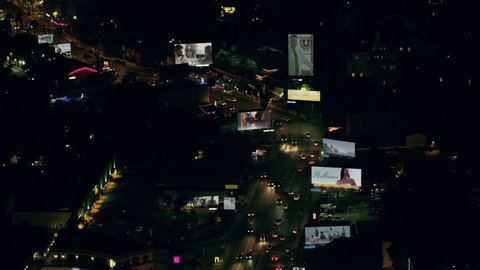 Aerial view of city traffic and billboards with our own advertisements on a clear night in Los Angeles, California. Shot on 4K RED camera.