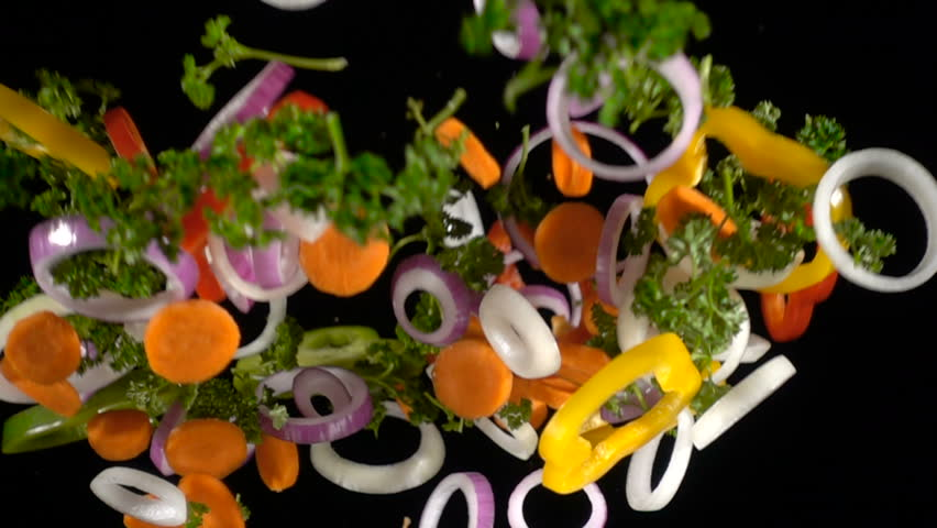 Falling slices of chopped vegetables isolated on black background, slow motion | Shutterstock HD Video #1020840958