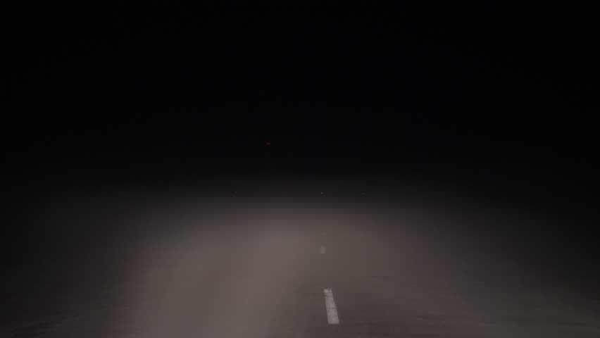 Shot in motion on a car at night in the headlights on the road in heavy fog and poor visibility, dangerous driving, slow motion | Shutterstock HD Video #1020860608