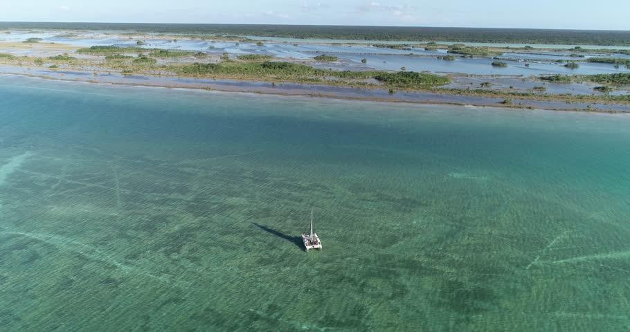 Catamaran sailing in Bacalar lagoon | Shutterstock HD Video #1020893878