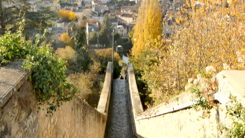 View of the city of Poitiers in the Vienne department, France. Camera movement. It starts with a view of the stairs and goes up to a panorama of the city in the background. Filmed during the fall. | Shutterstock HD Video #1020901168