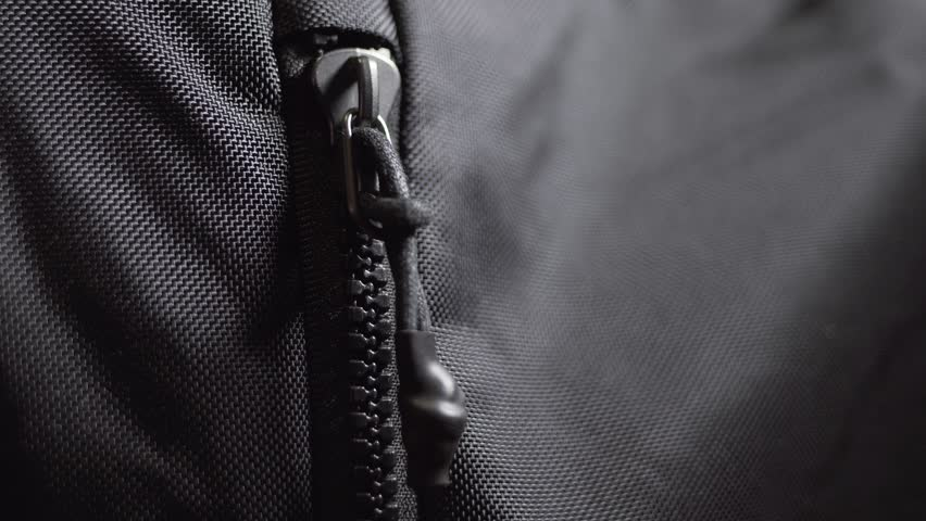 Unzipping Zip of a high quality travel backpack. Side view. - Close up, 4k. | Shutterstock HD Video #1020902068