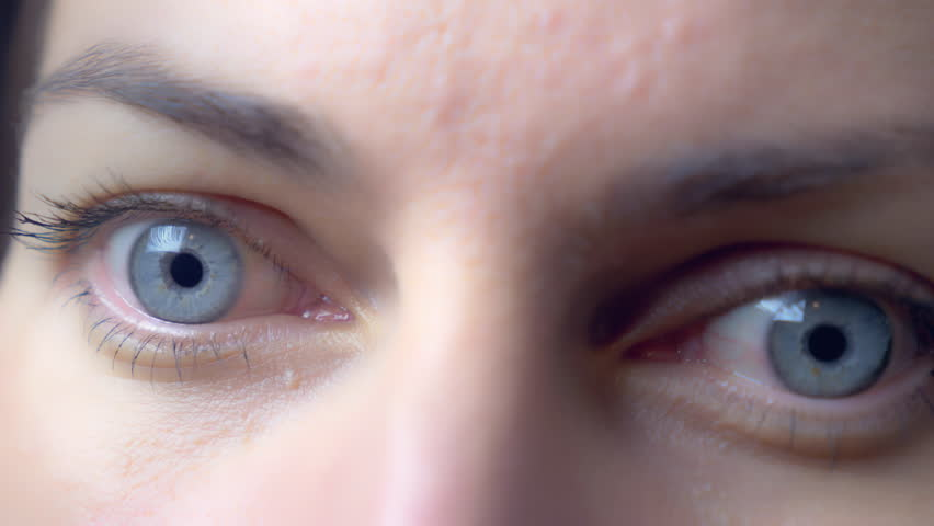 Female eyes close up, caucasian blue-eyed girl with make-up eyelashes, moving pupils and blinking eyelid, focus moves from one to another. Concept video for ophthalmology, stock video #1020971068