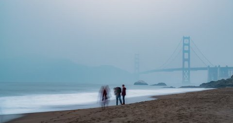 Baker Beach Golden Gate Bridge Time-lapse. a time-lapse shot of the Golden Gate Bridge in San Francisco from Baker Beach during fog and smoke from 2018 wildfires