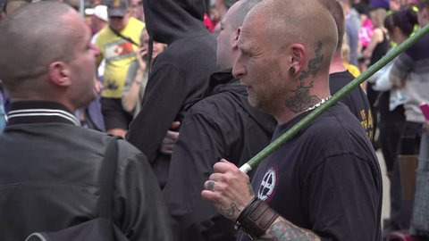 Worcester, United Kingdom (UK) - 09 01 2018: Far right skinhead displays white supremacy symbol