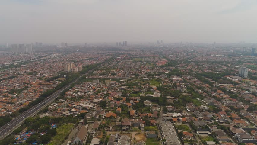 Aerial cityscape modern city Surabaya with skyscrapers, buildings and houses. city skyline with skyscrapers and business centers Surabaya capital city east java, indonesia | Shutterstock HD Video #1021059748