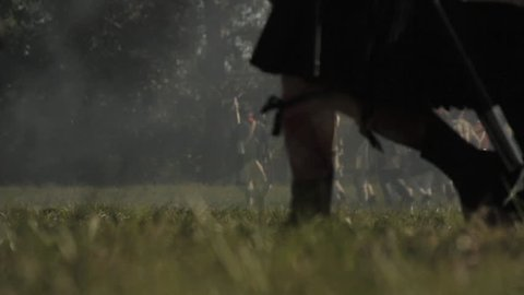 VIRGINIA - OCTOBER 2018 - Reenactment, large-scale, epic American Revolutionary War anniversary recreation - in the midst of battle.  Soldiers fall-back and retreat from the battle with flags & Smoke.