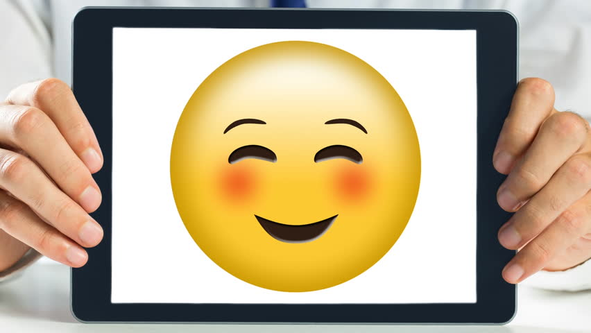Hands holding Tablet showing yellow happy satisfied emoticon smiling   Shutterstock HD Video #1021127128