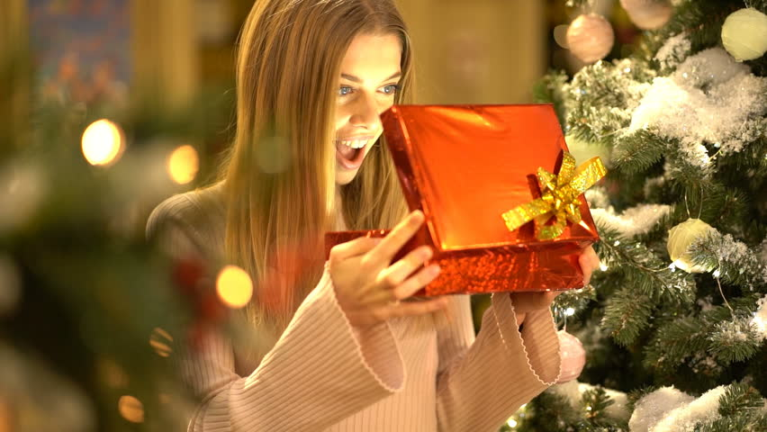 Beauty Girl Opens Christmas Gift Box With Magic Gift. Slow Motion | Shutterstock HD Video #1021164148
