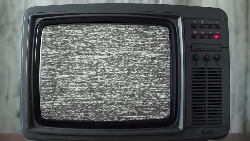 Static noise on a vintage TV set in a room | Shutterstock HD Video #1021217938