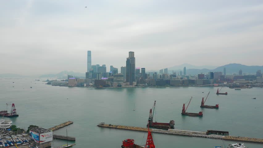 Day time cityscape downtown bay victoria harbour dock aerial panorama 4k hong kong | Shutterstock HD Video #1021235008
