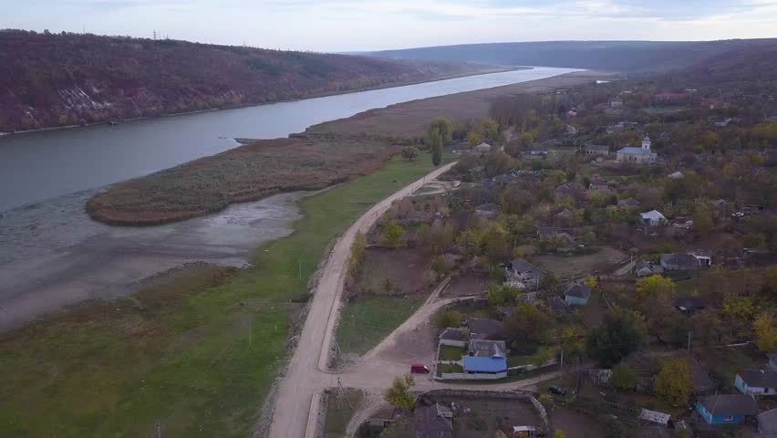Flight over Village and River. | Shutterstock HD Video #1021250608