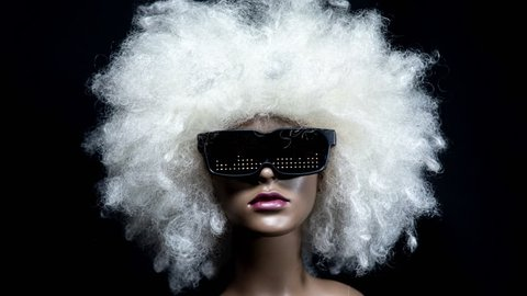 amazing mannequin with afro wig and sunglasses with led pattern on them. very 1980s retro. not a real model, this is a mannequin head