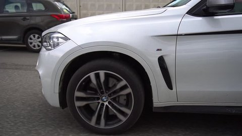 Moscow / Russia - 05 23 2018: White BMW M550D riding on the street. Big white fast SUV on the road.