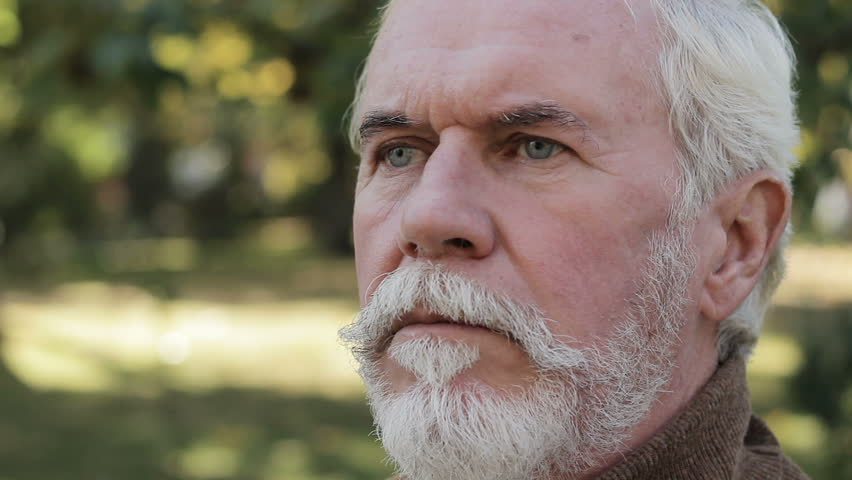 Portrait of frowning wrinkled senior man, staring ruefully, gloomily far away #1021497778