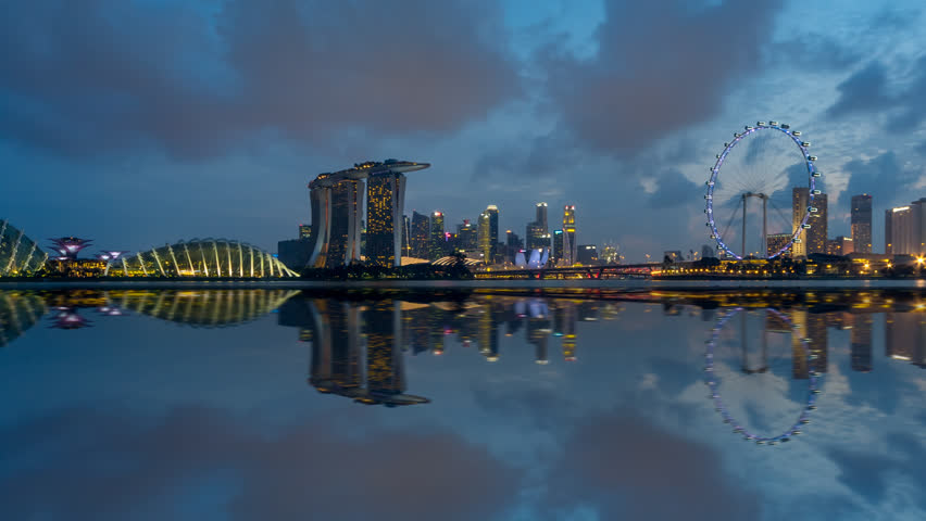 Beautiful Time lapse of Day to Night of Singapore skyline from afar with reflection. Prores. Pan right motion timelapse. 4K available. | Shutterstock HD Video #1021522648