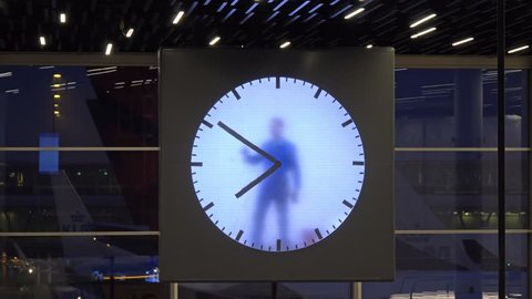 AMSTERDAM, NETHERLANDS - CIRCA FEB 2018: The Schiphol airport Real Time Schiphol Clock, by Maarten Baas, an art clock in the terminal, Amsterdam airport Schiphol, 4k