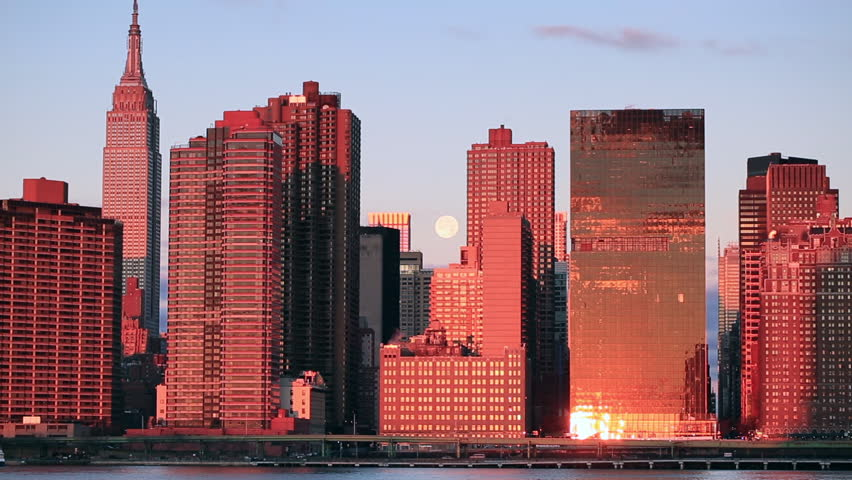 View on midtown Manhattan with full moon from East river at sunrise | Shutterstock HD Video #1021548838