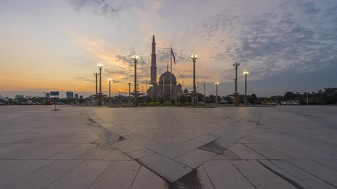 Dramatic Sunset Time Lapse at Putra mosque in Putrajaya, Malaysia at dusk. Prores 4K. Zoom in motion timelapse.