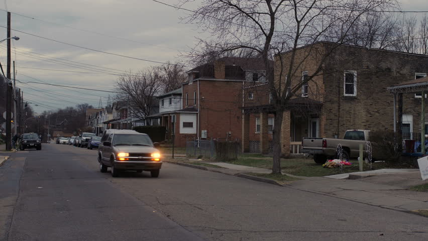 A daytime overcast winter establishing shot of a typical middle-class residential neighborhood. Pittsburgh suburbs.