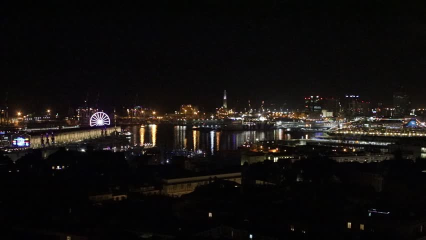 GENOA, ITALY - 12/22/2018: panorama on the ancient port in the evening at night, with ferris wheel and Christmas lights | Shutterstock HD Video #1021652668