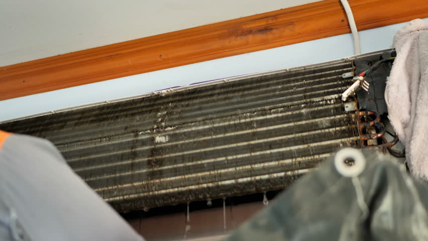 Male are repairman fixing and cleaning air conditioner unit by water in house. maintenance service. Slow Motion  | Shutterstock HD Video #1021719778