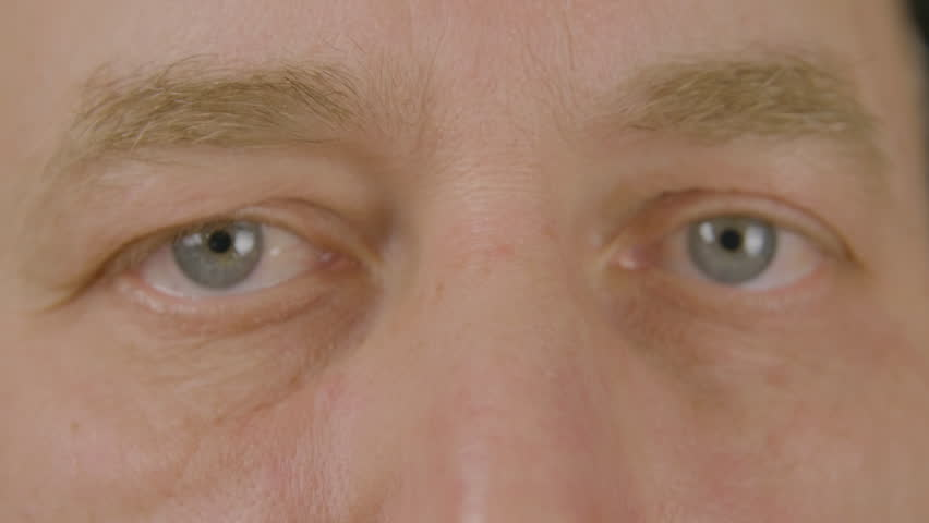 27d10de97d8 Man with opened eyes looking and blinking front camera close up. Face adult  man winking eye and looking into camera. Macro shooting male eyes.