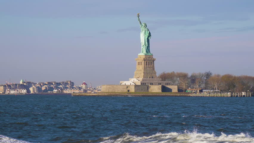 Statue of Liberty in the Sunny Day. New York City, United States of America. View from the Water. Steadicam Shot, Camera Tilts Up. Slow Motion | Shutterstock HD Video #1021854568