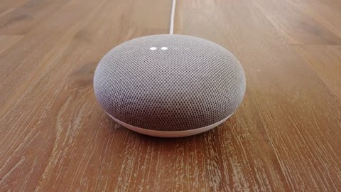Google Home Mini - Mini Smart Home Voice Assistant Controlled Gadget Responding To Command