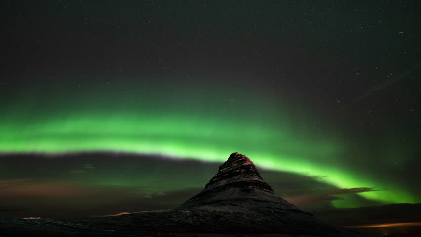 Aurora borealis at Mount Kirkjufell Iceland | Shutterstock HD Video #1021971928