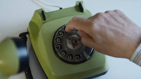 Man Dialing A Number On A Vintage Retro Rotary Phone