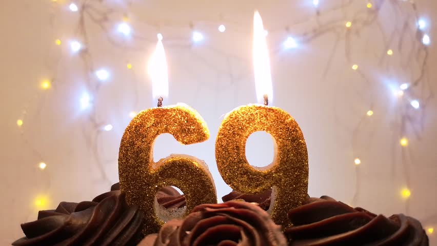Burning Birthday Candle On A Cake Number 69 Blow Out At The End Color Blurred Background