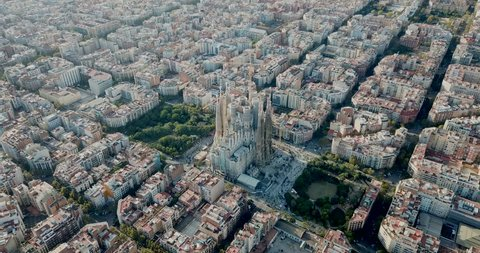 BARCELONA, SPAIN - OCTOBER 30, 2018: Modern urban landscape in Barcelona, panoramic view from drone of Eixample district and Sagrada Familia