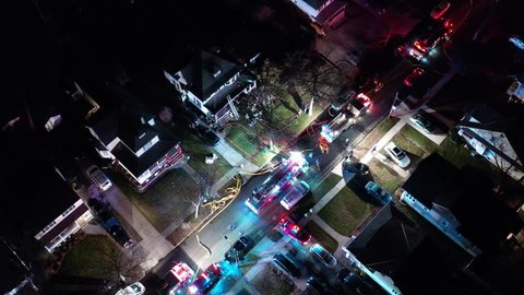 Aerial View of Fire Trucks and Apparatus on Scene of House Fire