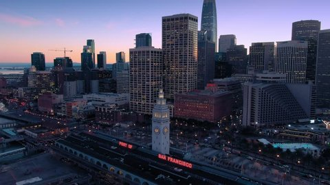 Aerial Drone Of The San Francisco City Skyline and Ferry Terminal at night.