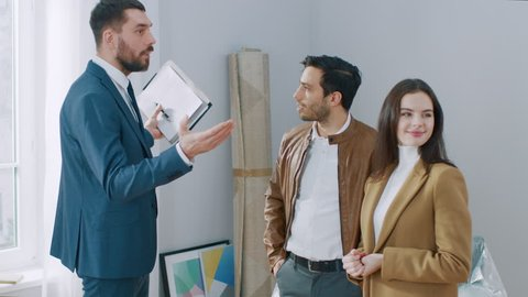 Professional Real Estate Agent Welcomes Young Couple at Home Showing. Young Couple Viewing New Property and Ready to Become Homeowners. Spacious Bright Apartment with Big Windows.