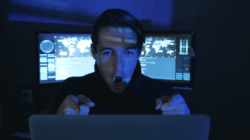 Portrait of Amazed Surprised Professional IT Programmer in a data center filled with monitor screens. Sudden Victory or Success | Shutterstock HD Video #1022097358