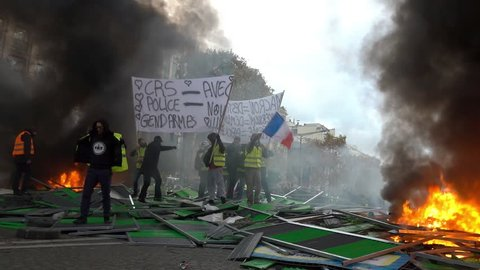 PARIS, FRANCE – Circa November: Protest and clashes on Champes Elysees of Yellow Vests or Gilets Jaunes on 2018 in Paris