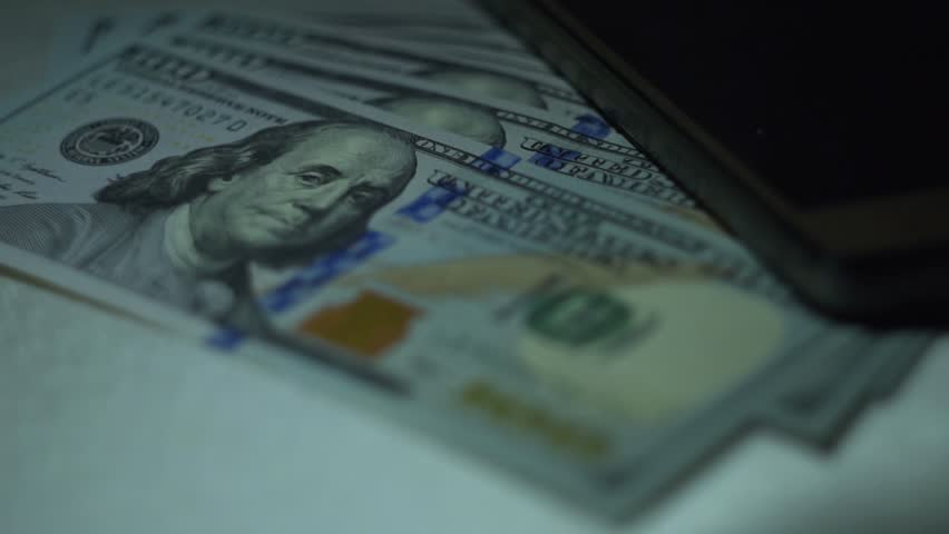 Dollars and smartphone. Close-up. | Shutterstock HD Video #1022147878