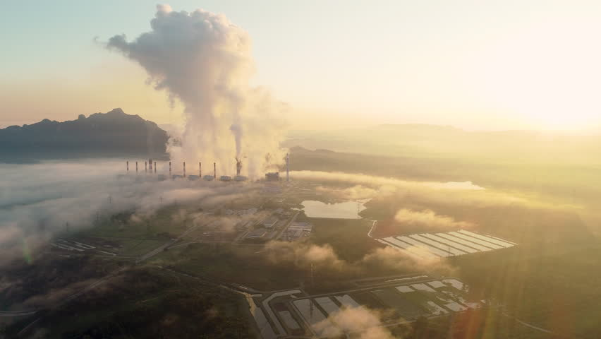 Aerial view of Coal power plant Throwing ash Into the atmosphere during Sunrise. The fog is beautiful. | Shutterstock HD Video #1022186338