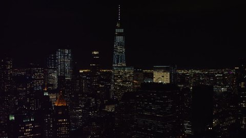 New York City at night with city lights in the winter. Aerial view of skyscrapers and buildings, busy streets and night sky. Shot on 4k RED camera on helicopter.
