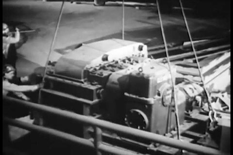 CIRCA 1953 - Equipment is brought in to newly-constructed buildings of a steel mill.
