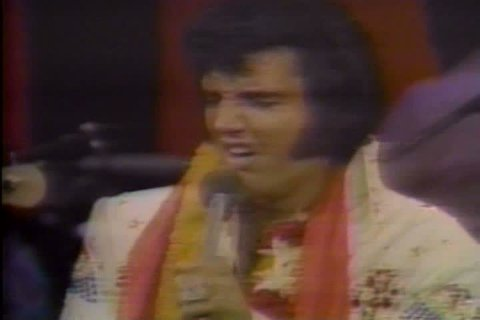 CIRCA 1987 - Footage from Elvis' last concert and his funeral are shown.