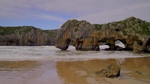 spectacular rock formations and beach on the coast of Cantabria, Spain