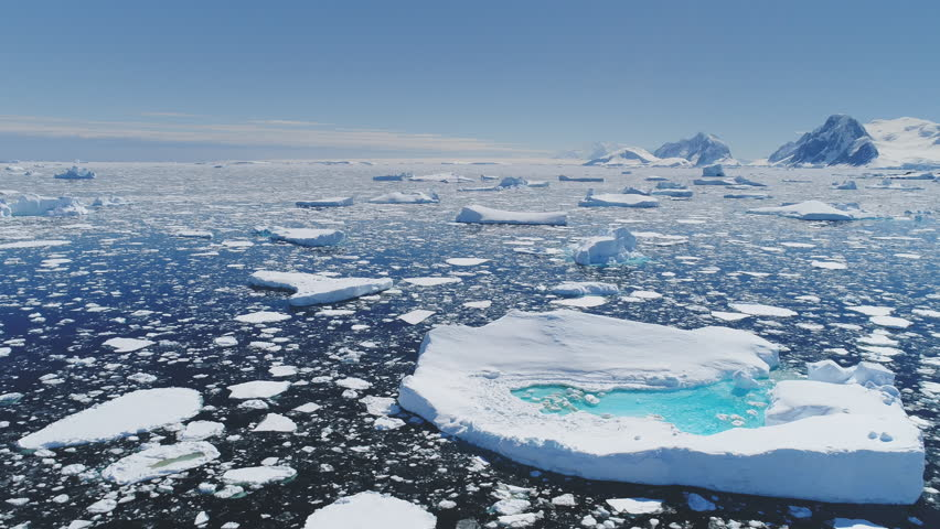 Antarctica Melting Blue Water Iceberg Aerial View. Antarctic Ocean Environment. Arctic Ice Nature Landscape of Global Warming and Climate Change Concept Top Drone Shot Footage 4K (UHD) | Shutterstock HD Video #1022388238