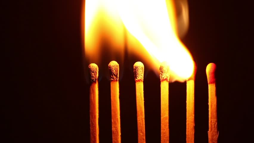 Ignition matches in sequence, metaphor of influence, chain reaction, domino effect.